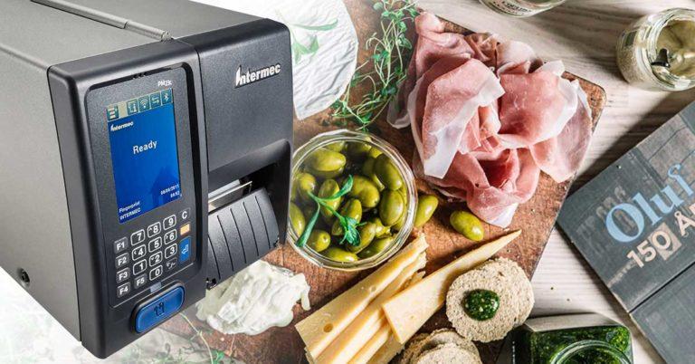 En etikettprinter sammen med matvarer